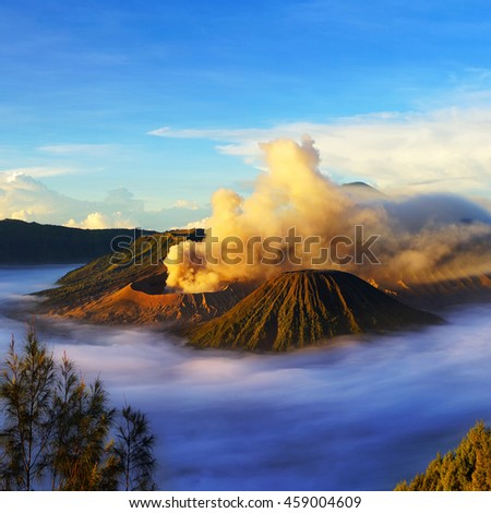 Mount Bromo, active volcano during sunrise with  cloud, it's located in Bromo Tengger Semeru National Park, East Java, Indonesia. - stock photo