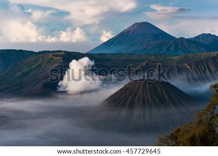 Mount Bromo volcano at morning, the steaming crater of Mount Bromo erupting in Bromo Tengger Semeru National Park, East Java, Indonesia. - stock photo