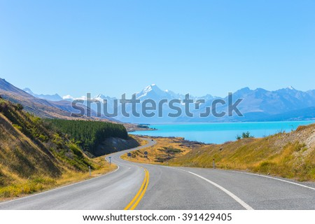 Mount cook viewpoint with the lake pukaki and the road leading to mount cook village in New Zealand. - stock photo