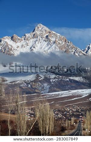 Mount Demirkazik at Aladaglar National Park in Nigde, Turkey. Mount Demirkazik is the highest mountain in Aladaglar. - stock photo