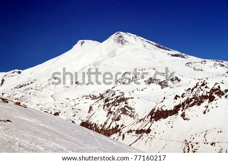 Mount Elbrus in the sunny winter day,Central Caucasus. The highest mountain in Europe. - stock photo