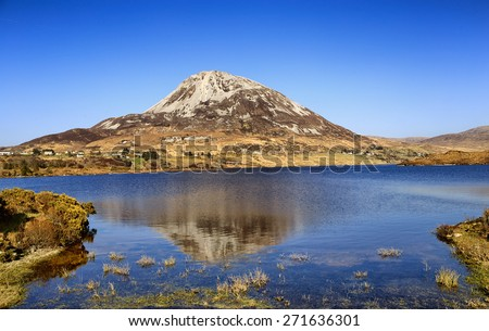 Mount Errigal, Co. Donegal, Ireland, reflected in blue lake surrounded by peatland in national park - stock photo