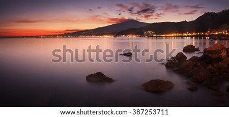 Mount Etna, in Sicily, seen from Taormina at sunset - stock photo