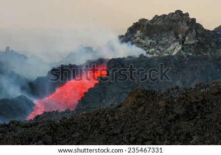 Mount Etna produces fountain of lava and ash during continued eruption - stock photo