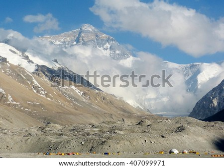 Mount Everest as seen from Everest Base Camp from Tibet side.  The little tents in the foreground are those of the climbers of Mount Everest. - stock photo