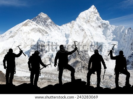 Mount Everest from Kala Patthar and silhouette of men - trek to everest base camp - Nepal  - stock photo