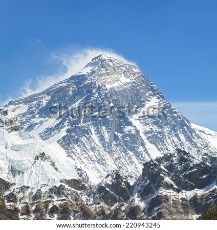Mount Everest (8848 m) and Lhotse (8516 m) from the Ngozumba Tsho (the fifth Gokyo lake) - Nepal, Himalayas - stock photo