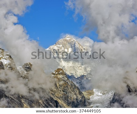 Mount Everest (8848 m) in the clouds. View from the Renjo Pass (5360 m) - Gokyo region, Nepal, Himalayas - stock photo