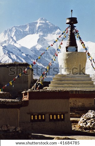 Mount Everest, the highest in the world, 8850 m. View from monastery Rongbuk (5100 m), Tibet. China. In the foreground the Rongbuk Monastery (about 5100 m, the highest monastery in the world). - stock photo