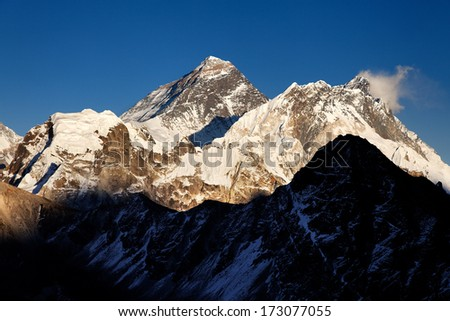 Mount Everest towering over lesser peaks in a view from Gokyo Ri, Nepal Himalaya - stock photo