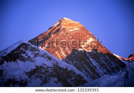 Mount Everest with clear blue sky in the Nepal Himalaya mountain range - stock photo