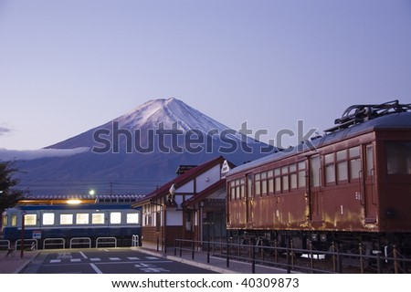 Mount Fuji at dawn at the train station. Japan. - stock photo