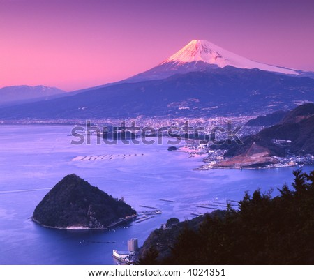 Mount Fuji at night with Suruga Bay in foreground - stock photo
