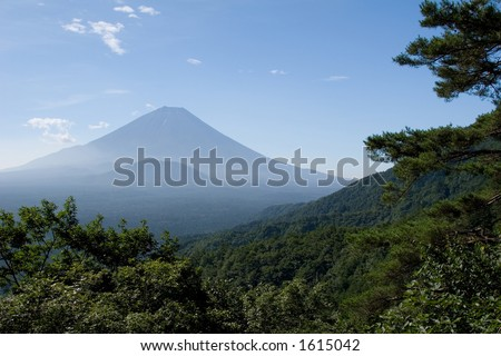Mount Fuji in midsummer viewed from an adjacent mountainside