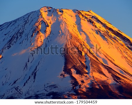 Mount Fuji in sunset glow, a world heritage in Japan - stock photo