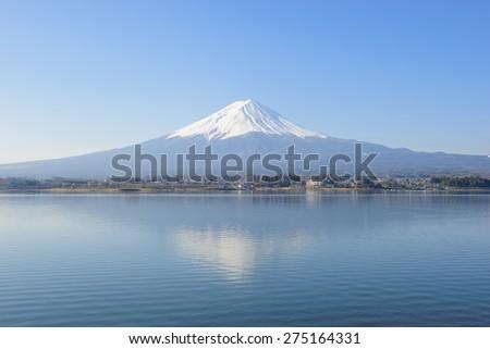 Mount Fuji reflected in Lake Kawaguchi - stock photo
