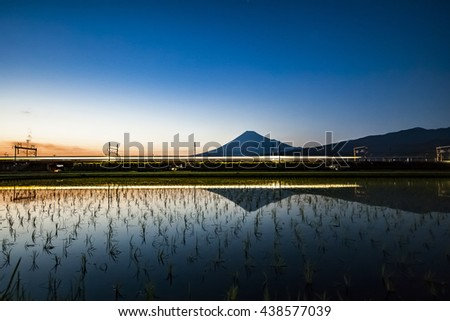 Mount Fuji, the bullet train light and planting of rice, Japan  - stock photo