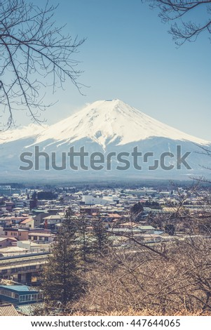 Mount Fuji view from Red pagoda in japan (Vintage filter effect used) - stock photo