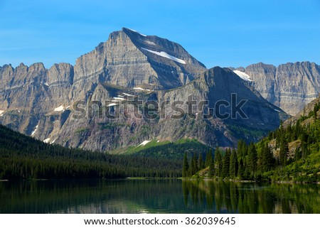 Mount Gould and Lake Josephine in Glacier National Park - stock photo