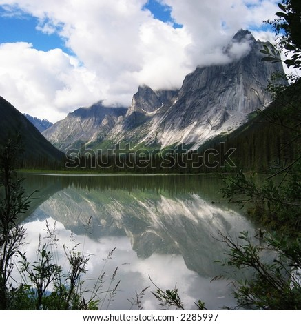Mount Harrison Smith reflected in Glacier Lake