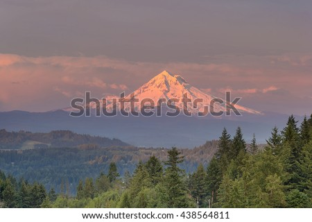 Mount Hood evening alpenglow during sunset from Happy Valley Oregon - stock photo