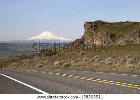 Mount Hood stands out on the Oregon side traveling along the Columbia River - stock photo
