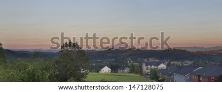 Mount Hood View at Sunset in Oregon Suburbs Housing Neighborhood Panorama - stock photo