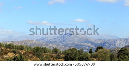 Mount Kedros and distant, misty Mount Ida (Psiloritis), said in mythology to be the birthplace of Zeus, king of the Greek gods, seen from the foothills of Crete's White Mountains, or Lefki Ora