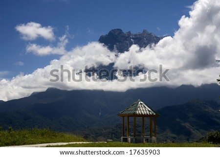 Mount Kinabalu in the clouds - stock photo