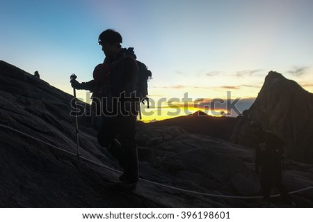 Mount Kinabalu,Ranau,Sabah.Malaysia-March 12,2016: Unidentified climber passing trail to the summit Mount of Kinabalu.The trails open up to Laban Rata after two months closure due to earthquake.