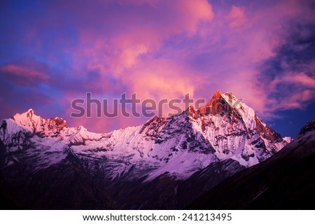 Mount Machapuchare (Fishtail) at sunset, view from Annapurna base camp. Machapuchare or Machhaphuchhare is a mountain in the Annapurna Himal of north Central Nepal. - stock photo