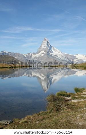 Mount Matterhorn mirroring in the lake Riffelsee - stock photo