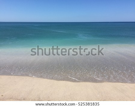 Mount Maunganui and Main Beach turquoise crystal clear water and blue sky