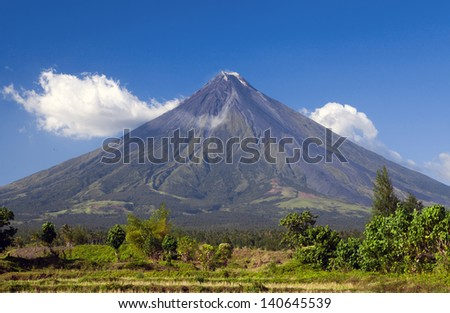 Mount Mayan volcano in the Province of Albay, Bicol, Luzon, Pilippines is considered the world's most perfectly formed cone because of its symmetry. A recent eruption April 2013 killed five climbers. - stock photo