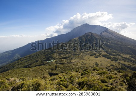 Mount Meru near Arusha in Tanzania. Africa. Mt Meru is located 60 kilometres west of Mount Kilimanjaro. - stock photo