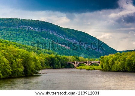 Mount Minsi and the Delaware River seen from from a pedestrian bridge in Portland, Pennsylvania. - stock photo
