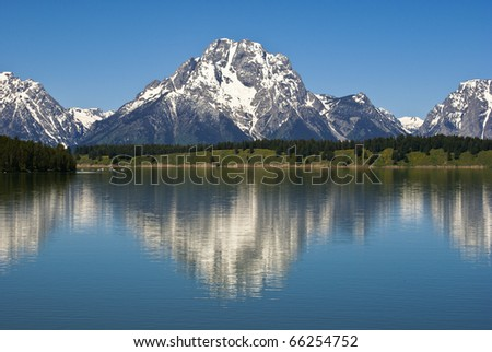 Mount Moran reflecting in Jackson Lake, in Grand Teton National Park, Wyoming.