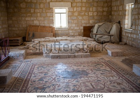 MOUNT NEBO, JORDAN - Apr 28, 2014: Mosaic floor in Mount Nebo. which is mentioned in the Bible as the place where Moses was granted a view of the Promised Land that he would never enter. - stock photo