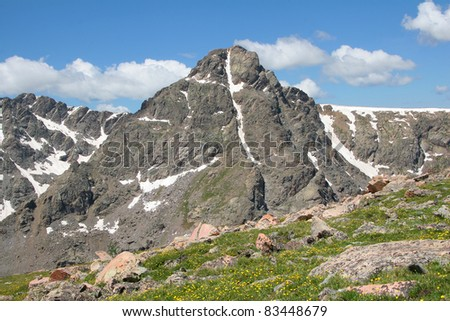 Mount of the Holy Cross, a Colorado Fourteener (over 14,000 foot elevation).  Snow in the couloir of the mountain face forms a cross. - stock photo