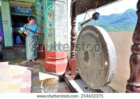 MOUNT POPA, MYANMAR - CIRCA NOVEMBER 2014: A big gong in the monastery of Mount Popa in MYanmar (Burma) circa November 2014.  - stock photo