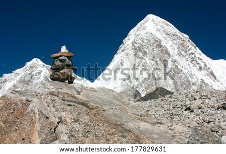 Mount Pumo Ri and stone man near Everest base camp - Nepal - stock photo