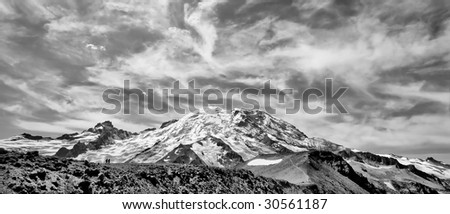 Mount Rainer National Park on a cloudy day in black and white - stock photo