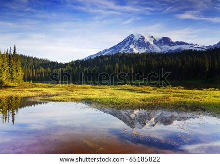 Mount Rainier Morning This image was taken at Reflection Lakes in Mt. Rainier National Park, WA. - stock photo