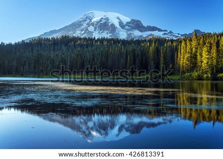 Mount Rainier with its reflection in the lake, Washington State, USA - stock photo