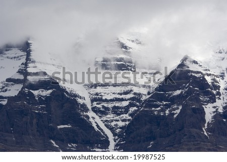 Mount Robson with snow and peak in clouds, Canada - stock photo