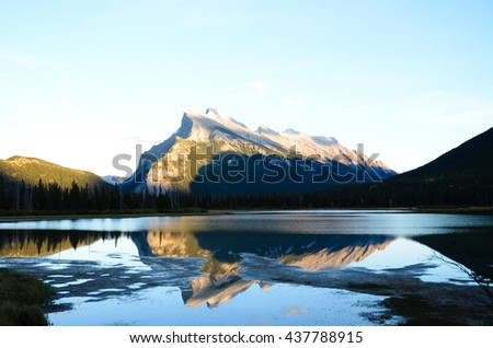 Mount Rundle and Vermillion Lake Shined by the Setting Sun in Autumn, Canadian Rockies - stock photo