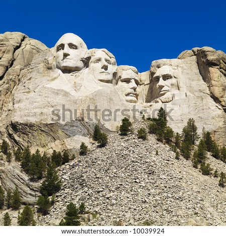 Mount Rushmore National Memorial with mountain and trees. - stock photo