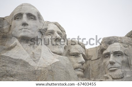 Mount Rushmore up close on a very overcast day - stock photo