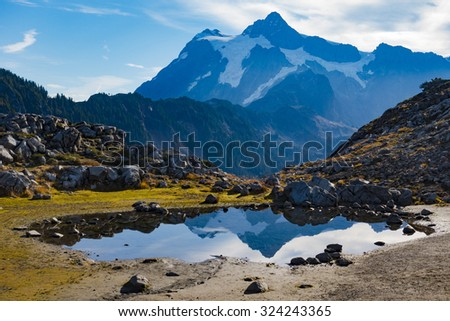 Mount Shuksan Lake Reflection Autumn Sunrise - stock photo