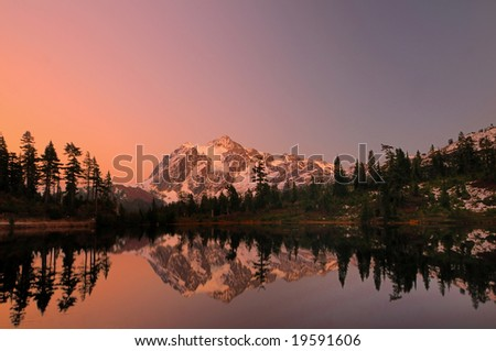 Mount Shuksan with the alpine glow after sunset - stock photo